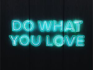 black background with the words 'do what you love' in blue neon text